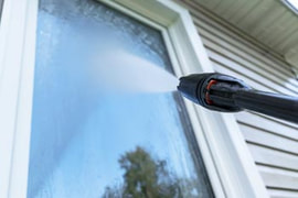 Pressure washing house window