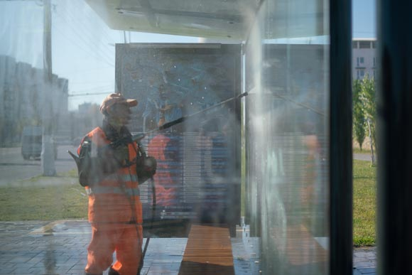 Professional pressure washing bus stop window